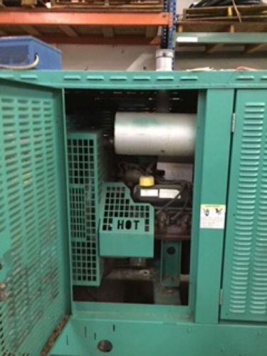 Enclosed onan generator 80kw pre-owned low hours
