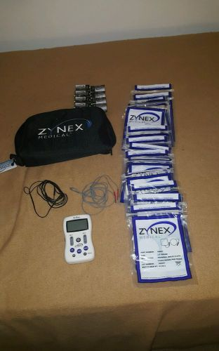 Zynex medical electrotherapy electrodes muscle theropy w/ batteries and 56 pads